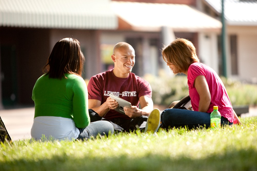 Lenoir-Rhyne University students take a break on the lawn outside the student center.