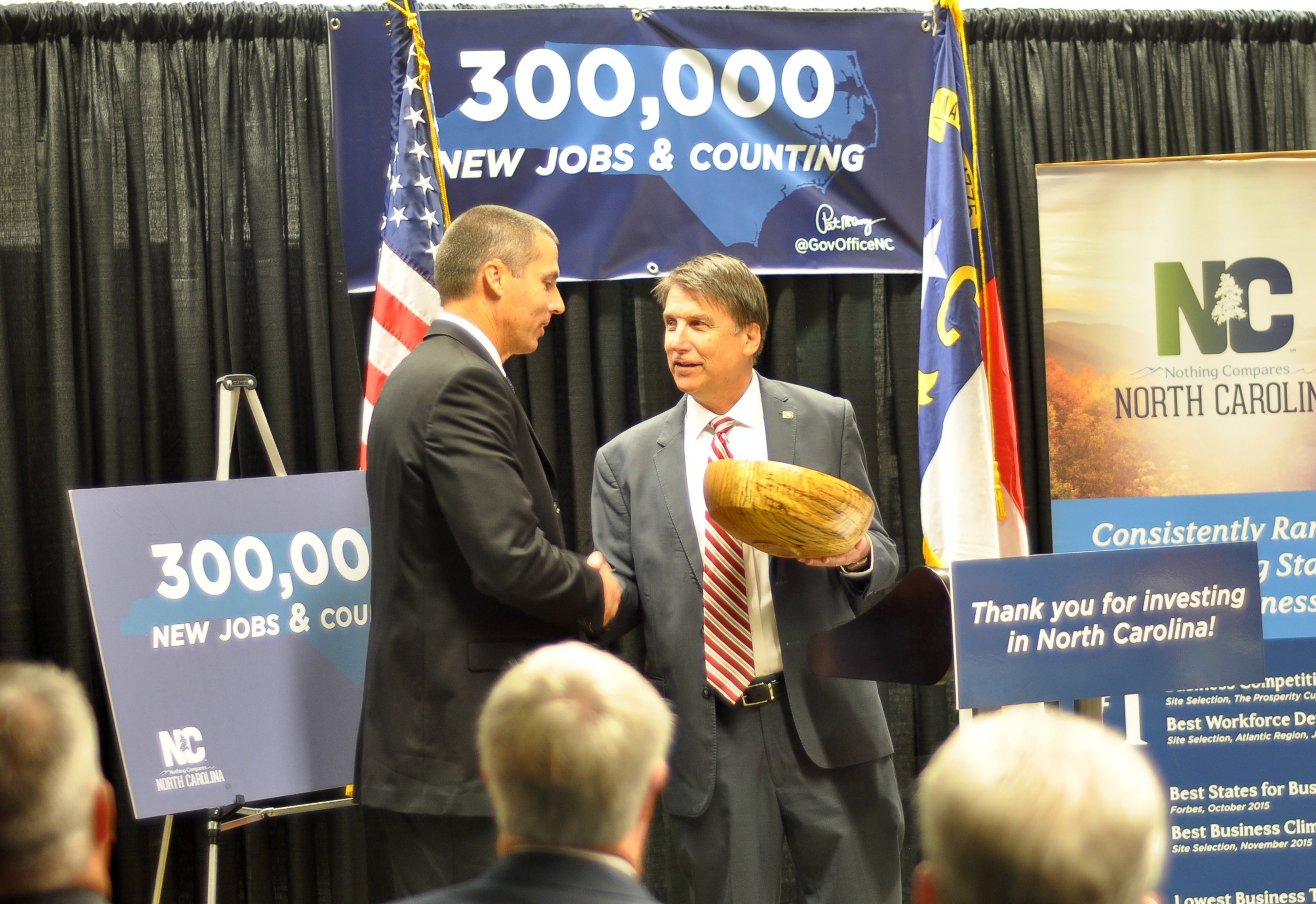 Gov. Pat McCrory presents Corning Optical Communications' Don Hefner (Regional Engineering Manager) with a handcrafted award commemorating the expansion announcement.